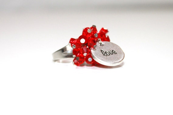 Beaded ring made from Swarovski crystal beads (Red Siam) with a reversible charm 'Love / Amour'