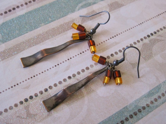antiqued copper charm cluster earrings with wire wrapped deep red and golden yellow glass beads