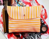 SUEDE CLUTCH (m) // pink suede with orange yellow stripe print