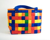 Colorful shopping assistant or happy bag for the beach