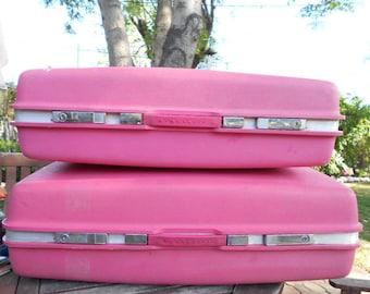 2 more hot pink Samsonite suitcases