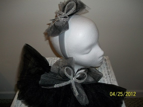 black tutu with silver and black tule bows on tutu and headband. Comes as a set