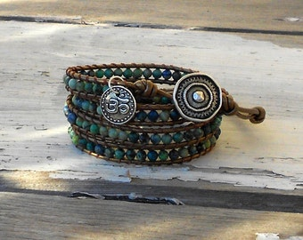 Chrysocolla leather wrap bracelet featuring om charm yoga with teal, green, and brown gemstone beads on bronze leather