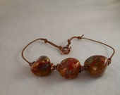 Chunky gold, green and red stone choker.
