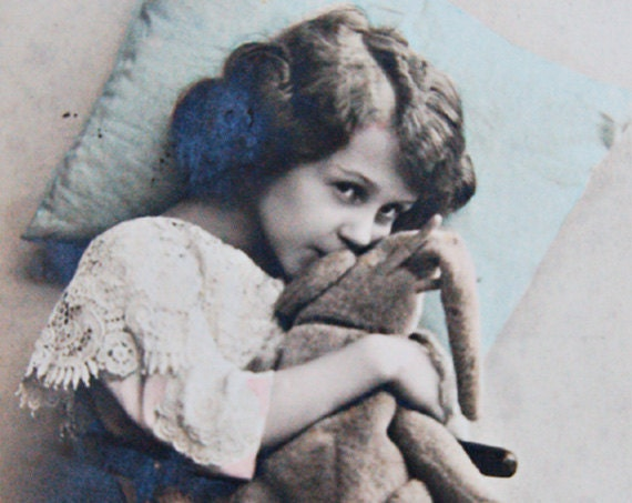 Delightful Coloured  Real Photographic Postcard of a Young Girl Cuddling Toy Elephant