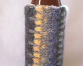 Koozie with cool shades of blue, green, yellow, and purple from an upcycled sweater