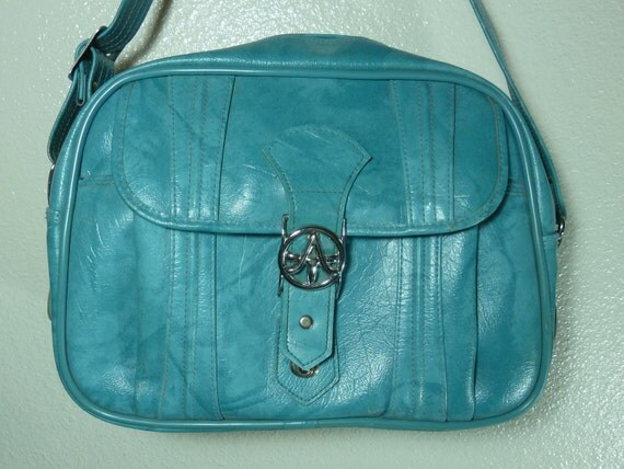 Turquoise American Tourister Carry On Luggage