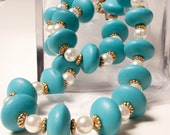 Turquoise wood beads with white glass pearls and gold tone daisy spacers