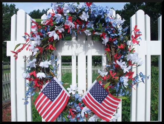 Patriotic Decorative Wreath, with red white and blue artificial flowers and American Flags