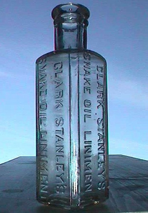 Ultimate Antique Quack Medicine Bottle SNAKE OIL LINIMENT.  This is the original real thing- over 100 years old -
