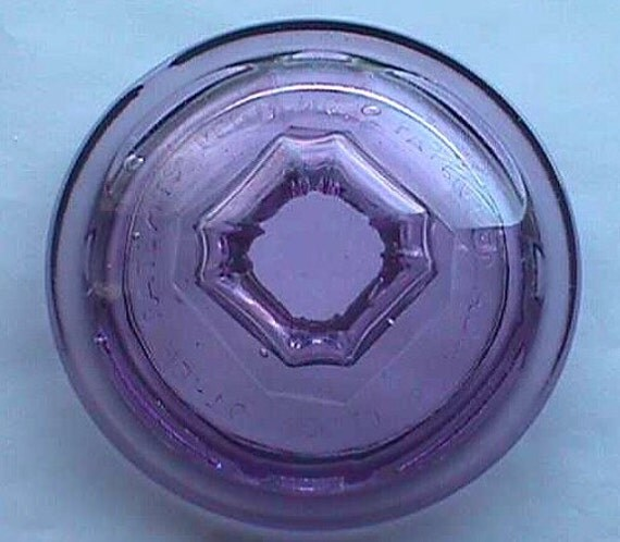 Great old glass CIGAR JAR cover w/  humidor.   Documented over 100 years old, spelling error in embossing, beautiful sun color purple