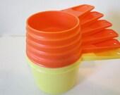 SaLe.....R E T R O.....Orange and Yellow Tupperware Nesting Measuring Cups