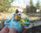 Pissed of chick with PMS ( blue  hen with yellow egg) Förbannad höna