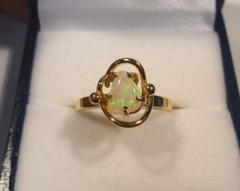 Ladies Opal Ring 14ct Yellow Gold  Claw Set Free Form Solid Opal. item 30117.