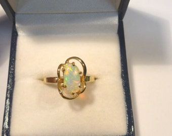 Ladies Opal Ring 14ct Yellow Gold  Claw Set Free Form Solid Opal. item 30964.