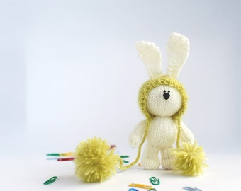 White rabbit in a light green hat  - knitting pattern