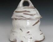 finger marked white slipped terra cotta jar