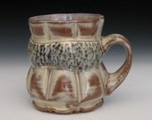 black spotted band yellow and brown fluted mug