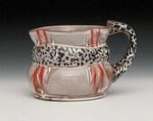 red striped white slipped black dotted mug 2