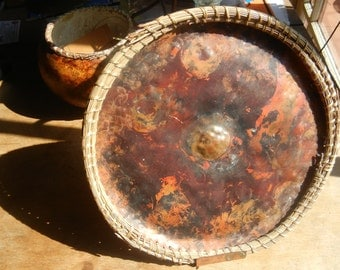 Hand formed sculptural copper plate with stitched pine needle rim and fire licked patina