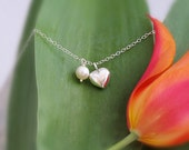 White freshwater pearl and puffed sterling silver heart on Sterling silver necklace