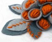 Crochet floral brooch, orange and grey