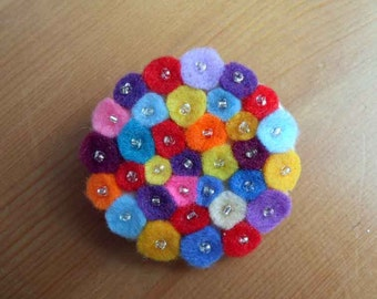 Multicolourful felt brooch with seed beads