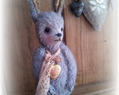 Vintage Style mohair bunny rabbit sculpture with gold photo locket.