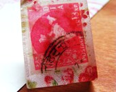 Indian red/pink postage stamp with a vintage fabric - pendant