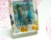 Indian turquoise/blue postage stamp with a vintage floral fabric - pendant