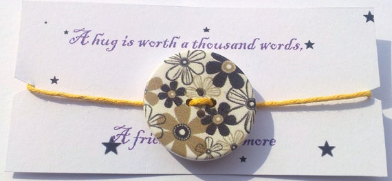 A Friend is Worth the World Monochrome button friendship bracelet on waxed cotton cord