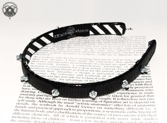 Handmade black leather headband with silver bolts. Sample sale. Only one available.