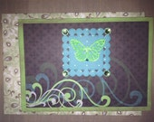 Happy Birthday Card for Men with Flourish Design in Blue, Green and White and an Embossed Butterfly on Frame with Rhinestones