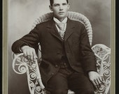Cabinet Photo, 1800s: Handsome Young Man Seated White Wicker Chair, A Farmer's Hands by Eagle Art Gallery, Blue Earth City, MN