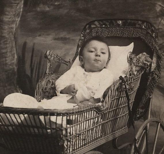 Victorian Cabinet Photo, 1800s: Baby in Ornate Wicker Pram makes Strange Face by Girgson & Henry Veedersburg, Ind.
