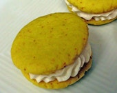 Lemon Cream Sandwich Cookies -- Light and Fluffy Vanilla Butter Cream sandwiched between Vibrant Lemon Cookies
