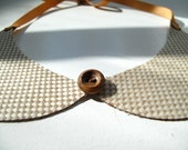Tiny checked oil cloth Peter Pan collar...