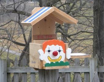 Orange hair clown squirrel/bird feeder