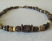 Brown unisex African necklace with batik cow bone, recycled paper beads, seeds, and wood