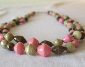 African recycled paper necklace in blush pink, taupe beige, and chocolate brown