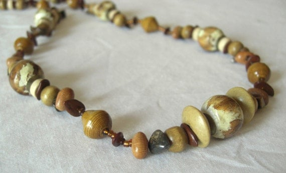 Golden brown and cream African clay necklace with recycled paper, beans, seeds, stones, and wood