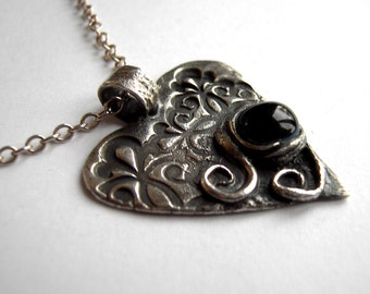 Unique silver heart necklace with swirls