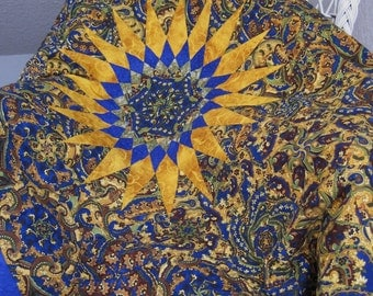 Blue paisley One Block Wonder lap quilt with large golden sun motif