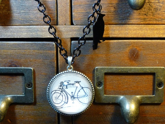 black bicycle pendant necklace by vintagerust