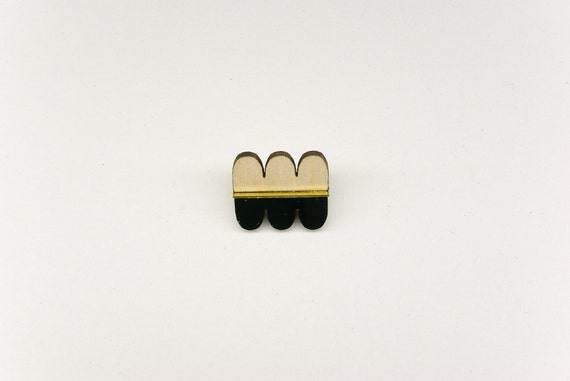 pin's Cazillon made of natural wood, brass and black plexiglas