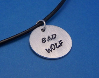 Bad Wolf - A Hand Stamped Aluminum Disc Necklace