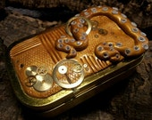 Gold steampunk Cthulhu tentacle mechanical tin