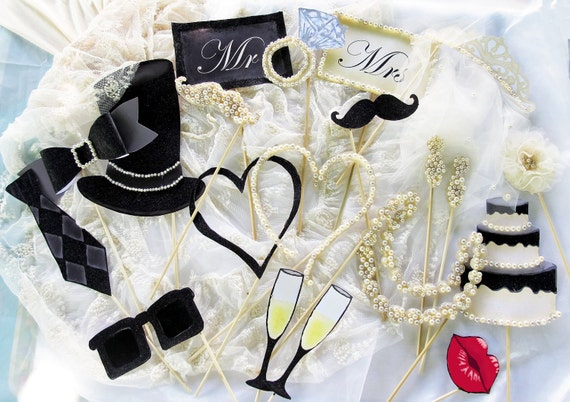 Pearls, glitter, tulle and lace photo booth props for an elegant wedding, anniversary or simply a chic party
