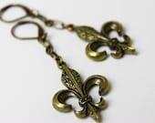 Antiqued brass Fleur de lis Dangle Earrings.