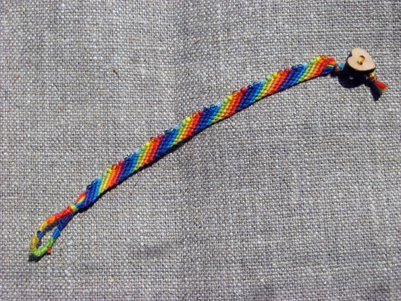 Friendship bracelet in rainbow colors with beads